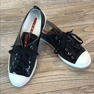 Prada Black patent leather sneakers.